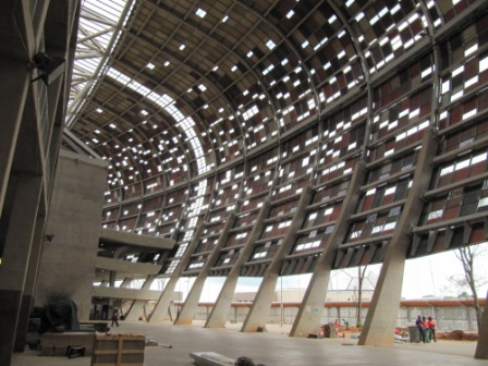 The encasing outer  structure pierced with openings, showinf the clear strip oriented to the  CT Stadium