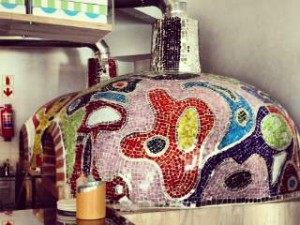 The colourful mosaic-ed pizza oven