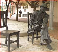 Life-size bronze sculpture of Kippie Moeketsi by Guy du Toit and Egan Tania outside the old Kippies. An empty sculpted chair encourages the viewer to sit next to  bra Kippie, represented as a lone, lonely and alone musician
