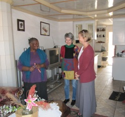 Memory Ngoyi, Kim Miller and Barbara Buntman in the living room of Memory's house